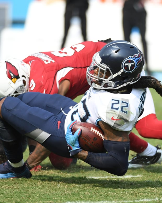 Tennessee Titans running back Derrick Henry (22) is tackled after a reception during the second half against the Arizona Cardinals at Nissan Stadium.