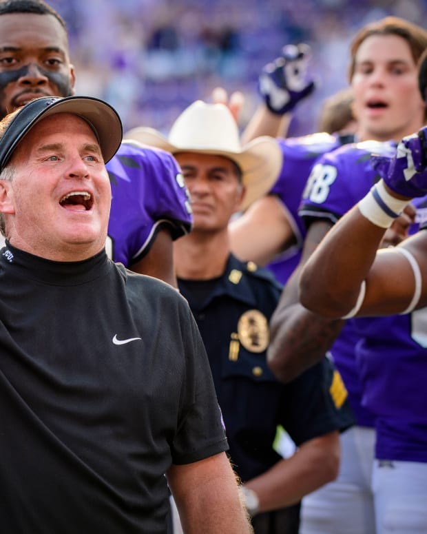 Sep 11, 2021; Fort Worth, Texas, USA; TCU Horned Frogs head coach Gary Patterson sings the school alma mater after the win over the California Golden Bears at Amon G. Carter Stadium.