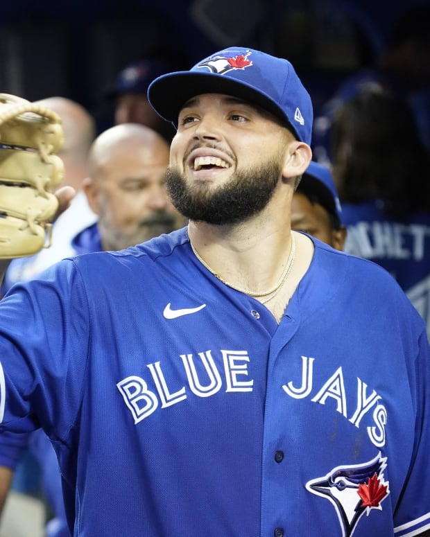 Toronto Blue Jays starting pitcher Alek Manoah (6) gets congratulated after the first inning against the Tampa Bay Rays at Rogers Centre.