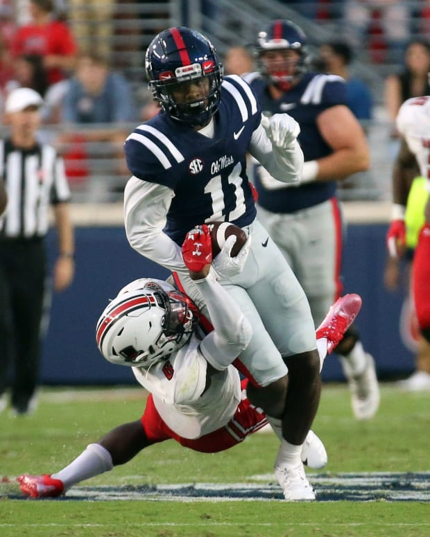 Sep 11, 2021; Oxford, Mississippi, USA; Mississippi Rebels wide receiver Dontario Drummond (11) runs the ball against Austin Peay Governors defensive back Kory Chapman (6) during the first quarter at Vaught-Hemingway Stadium.