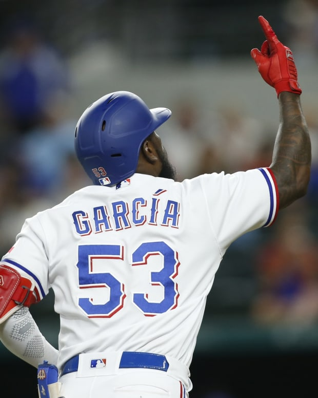 Sep 14, 2021; Arlington, Texas, USA; Texas Rangers right fielder Adolis Garcia (53) rounds the bases after hitting a home run in the third inning against the Houston Astros at Globe Life Field.