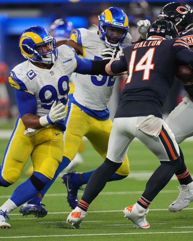 Sep 12, 2021; Inglewood, California, USA; Los Angeles Rams defensive end Aaron Donald (99) sacks Chicago Bears quarterback Andy Dalton (14) in the fourth quarter at SoFi Stadium. Mandatory Credit: Kirby Lee-USA TODAY Sports