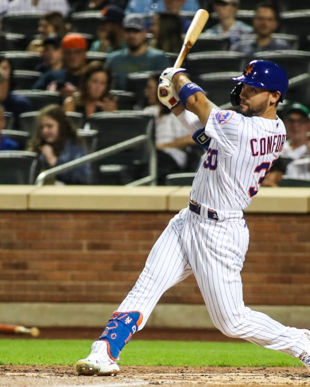 Sep 12, 2021; New York City, New York, USA; New York Mets right fielder Michael Conforto (30) hits an RBI single in the first inning against the New York Yankees at Citi Field.