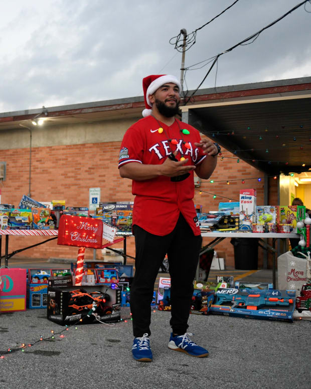 Texas Rangers' catcher and Corpus Christi native Jose Trevino removes his mask to film a promotion for his annual toy drive, Saturday, Dec. 19, 2020, at Westside Helping Hands. The toy drive purchased over $6,000 worth of toys for Christmas.
