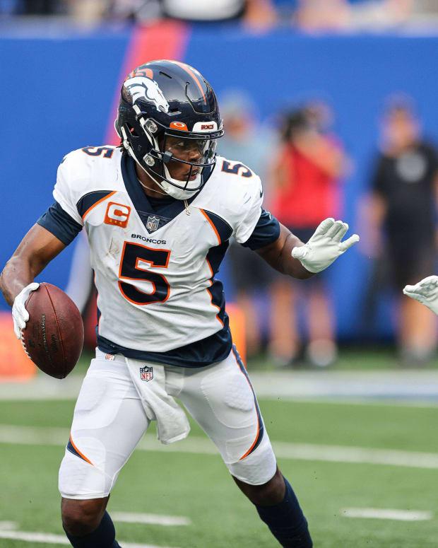 Denver Broncos quarterback Teddy Bridgewater (5) avoids New York Giants safety Xavier McKinney (29) to throw a touchdown pass during the second half at MetLife Stadium.