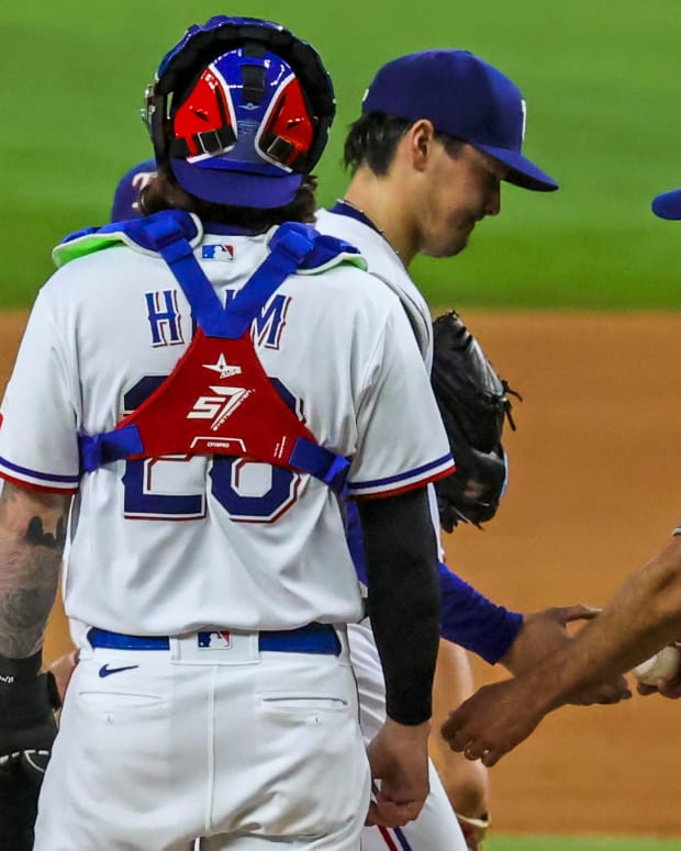 Sep 15, 2021; Arlington, Texas, USA; Texas Rangers manager Chris Woodward (8) removes starting pitcher Kohei Arihara (35) during the fifth inning against the Houston Astros at Globe Life Field.