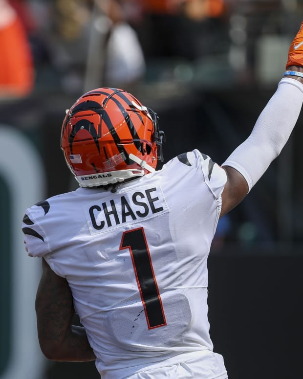Sep 12, 2021; Cincinnati, Ohio, USA; Cincinnati Bengals wide receiver Ja'Marr Chase (1) reacts after scoring a touchdown against the Minnesota Vikings in the first half at Paul Brown Stadium. Mandatory Credit: Katie Stratman-USA TODAY Sports