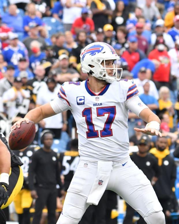 Buffalo Bills quarterback Josh Allen (17) throws a pass under pressure from Pittsburgh Steelers linebacker Alex Highsmith (56) and defensive end Tyson Alualu (94).