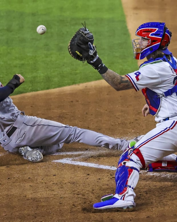 Sep 15, 2021; Arlington, Texas, USA; Houston Astros right fielder Kyle Tucker (30) scores ahead of the tag by Texas Rangers catcher Jonah Heim (28) during the fourth inning at Globe Life Field.