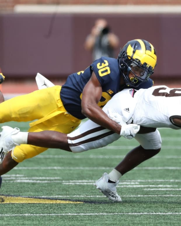Michigan Wolverines defensive back Daxton Hill tackles Western Michigan Broncos running back Sean Tyler during the second half Saturday, Sept. 4, 2021.  Mich West