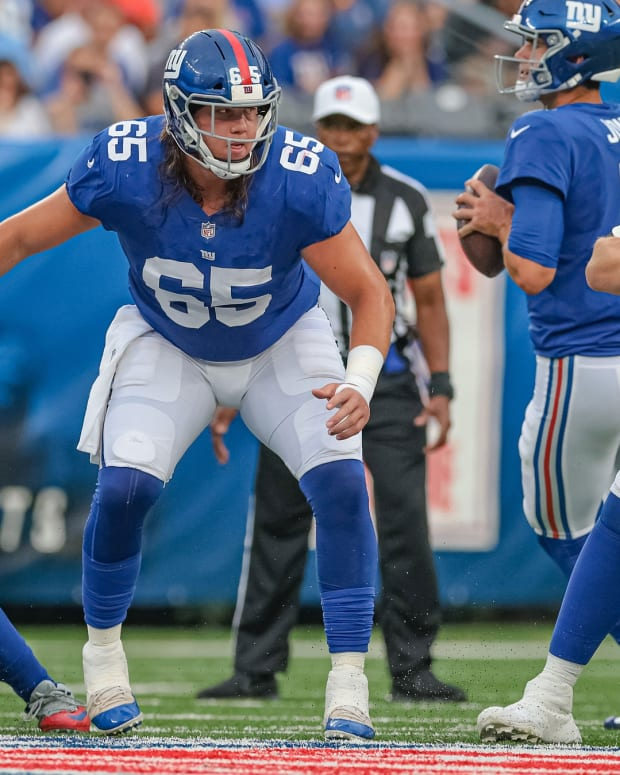 Aug 29, 2021; East Rutherford, New Jersey, USA; New York Giants center Nick Gates (65) blocks against the New England Patriots during the first half at MetLife Stadium.