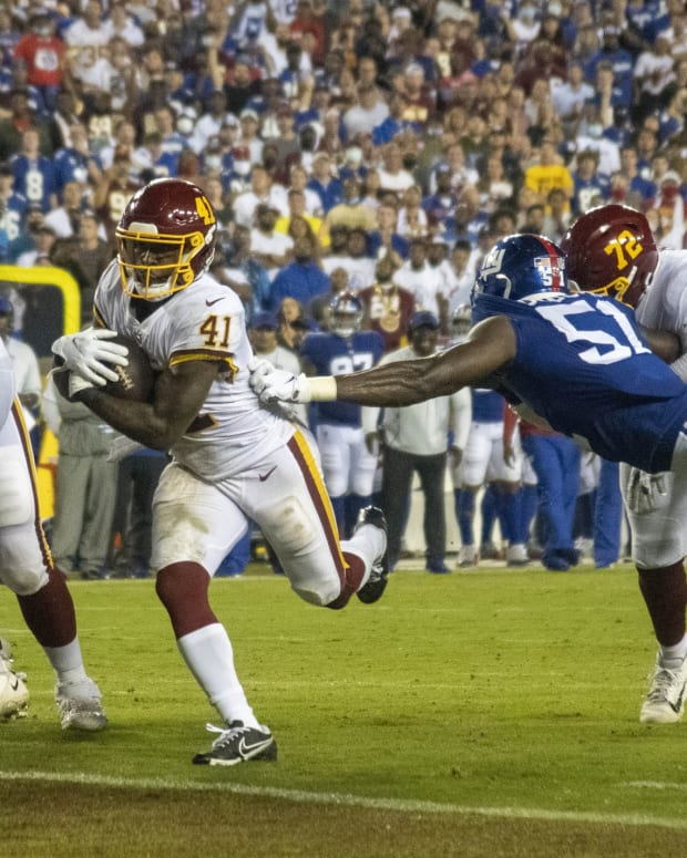 Sep 16, 2021; Landover, Maryland, USA; Washington Football Team running back J.D. McKissic (41) scores a touchdown against the New York Giants during the first half at FedExField.