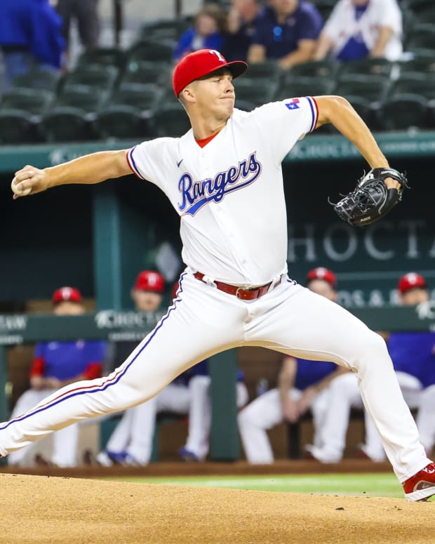 Sep 16, 2021; Arlington, Texas, USA; Texas Rangers starting pitcher Glenn Otto (49) throws during the first inning against the Houston Astros at Globe Life Field.