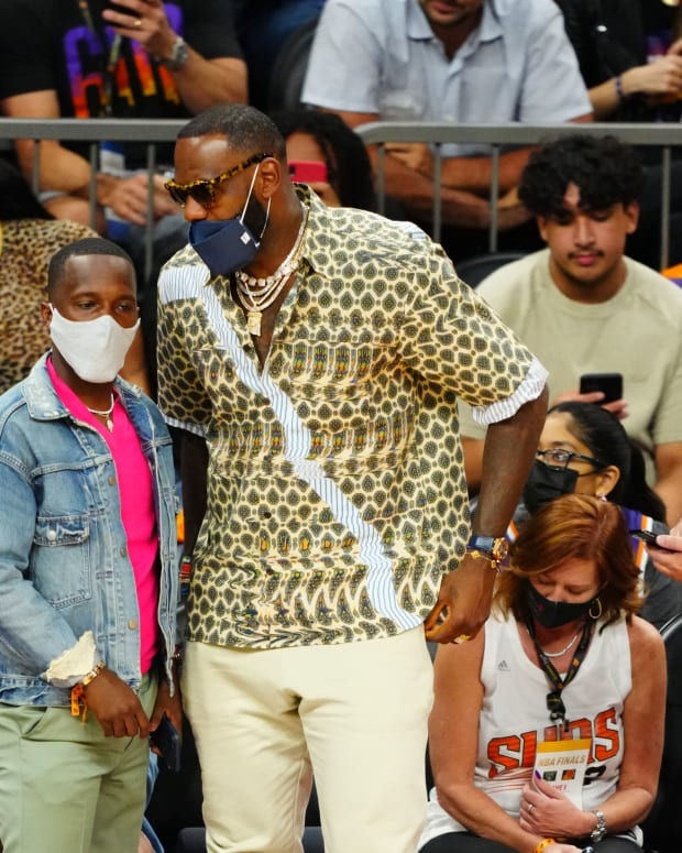 Los Angeles Lakers player LeBron James (right) with agent Rich Paul during game five of the 2021 NBA Finals. [Photo cropped so dimensions fit page]