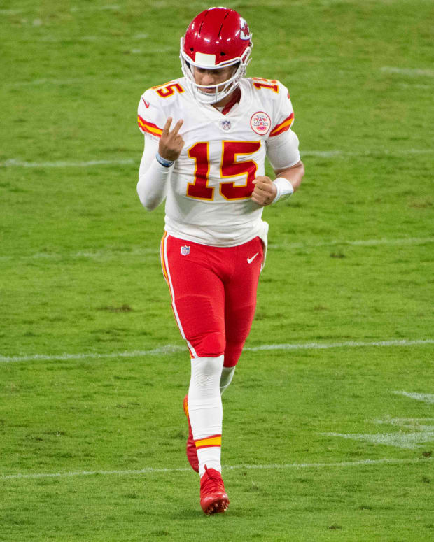 Sep 28, 2020; Baltimore, Maryland, USA; Kansas City Chiefs quarterback Patrick Mahomes (15) reacts after throwing a fourth quarter touchdown to offensive tackle Eric Fisher (not pictured) during the fourth quarter against the Baltimore Ravens at M&T Bank Stadium. Mandatory Credit: Tommy Gilligan-USA TODAY Sports