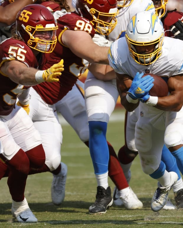 Sep 12, 2021; Landover, Maryland, USA; Los Angeles Chargers running back Austin Ekeler (30) carries the ball against the Washington Football Teamat FedExField. Mandatory Credit: Geoff Burke-USA TODAY Sports
