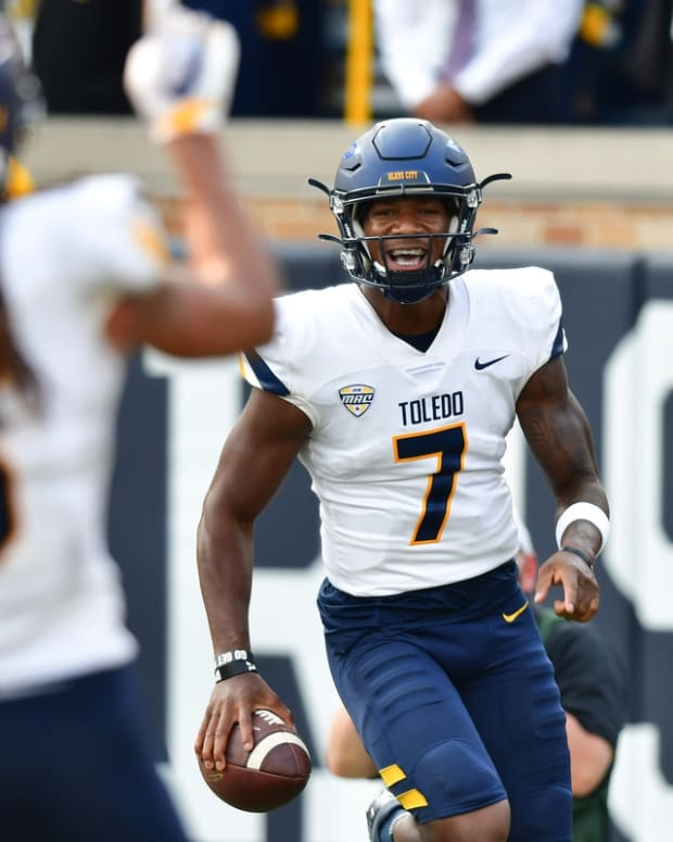 Sep 11, 2021; South Bend, Indiana, USA; Toledo Rockets quarterback Dequan Finn (7) celebrates after a touchdown in the fourth quarter against the Notre Dame Fighting Irish at Notre Dame Stadium. Mandatory Credit: Matt Cashore-USA TODAY Sports