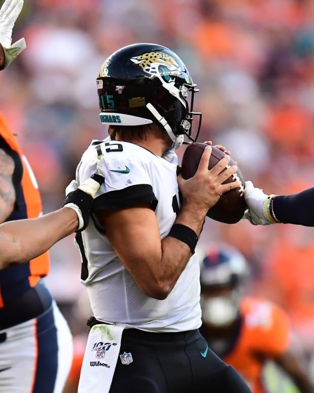 Denver Broncos defensive end Dre'Mont Jones (93) and outside linebacker Bradley Chubb (55) pressure Jacksonville Jaguars quarterback Gardner Minshew (15) in the fourth quarter at Empower Field at Mile High.