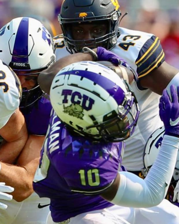 Freshman linebacker (43) contributes to a Cal defensive stop