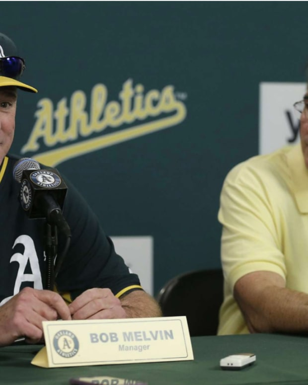 A's manager Bob Melvin and vice president of baseball operations Billy Beane.