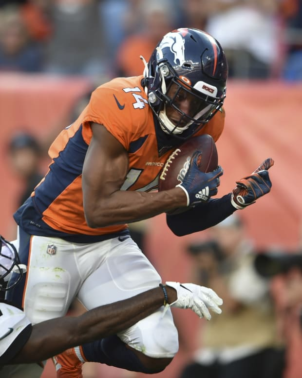 Denver Broncos wide receiver Courtland Sutton (14) hauls in a touchdown catch in the fourth quarter with Jacksonville Jaguars cornerback Tre Herndon (37) defending at Empower Field at Mile High.