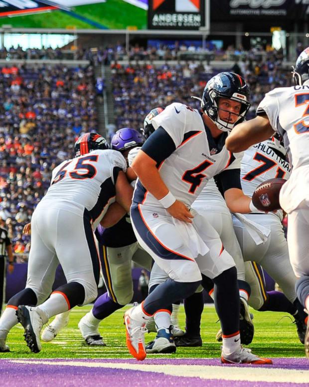 Denver Broncos quarterback Brett Rypien (4) and running back Damarea Crockett (39) in action against the Minnesota Vikings during the game at U.S. Bank Stadium.