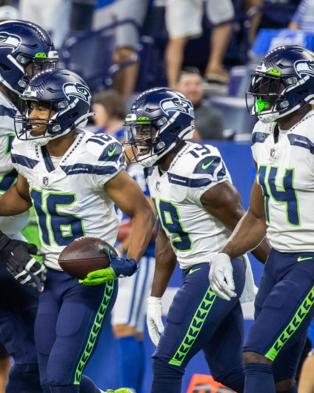 Seattle Seahawks wide receiver Tyler Lockett (16) celebrates his touchdown with teammates in the second quarter against the Indianapolis Colts at Lucas Oil Stadium.