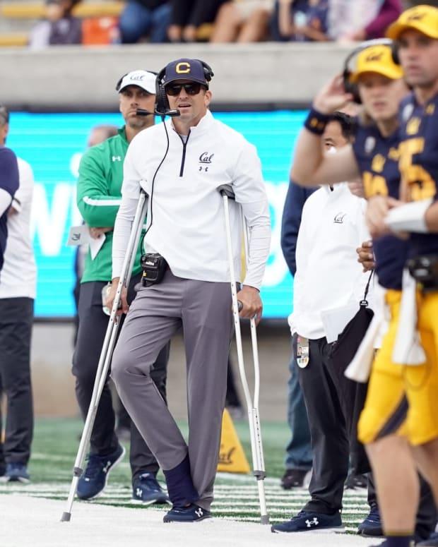 Justin Wilcox crutches Darren Yamashita