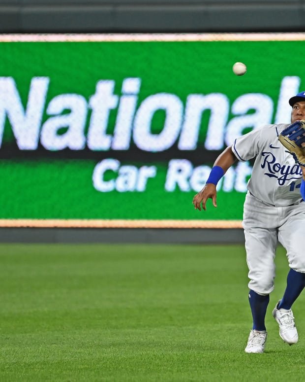 Sep 2, 2021; Kansas City, Missouri, USA; Kansas City Royals right fielder Edward Olivares (14) runs in to catch a fly ball during the ninth inning against the Cleveland Indians at Kauffman Stadium. Mandatory Credit: Peter Aiken-USA TODAY Sports