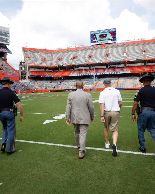 Alabama coach Nick Saban walks the field at Florida