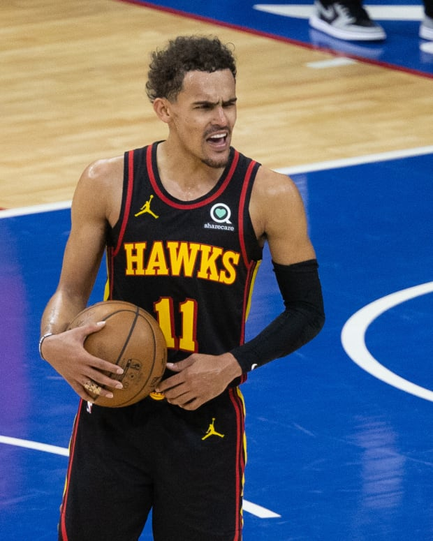 Atlanta Hawks guard Trae Young (11) reacts with fans in the closing seconds of a victory against the Philadelphia 76ers in game seven of the second round of the 2021 NBA Playoffs