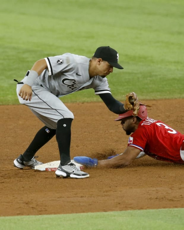 Sep 17, 2021; Arlington, Texas, USA; Texas Rangers center fielder Leody Taveras (3) steals second base against Chicago White Sox second baseman Cesar Hernandez (12) in the fifth inning at Globe Life Field.