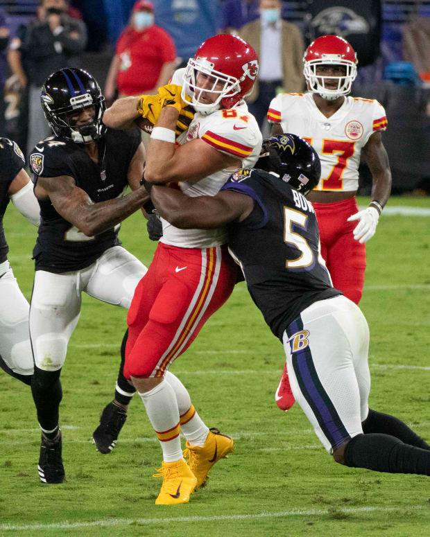 Sep 28, 2020; Baltimore, Maryland, USA; Kansas City Chiefs tight end Travis Kelce (87) runs for more yards as Baltimore Ravens linebacker Tyus Bowser (54) tackle during the first quarter at M&T Bank Stadium. Mandatory Credit: Tommy Gilligan-USA TODAY Sports