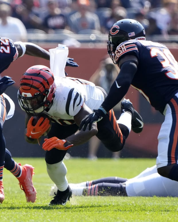 Sep 19, 2021; Chicago, Illinois, USA; Cincinnati Bengals running back Joe Mixon (28) rushes the ball Chicago Bears cornerback Kindle Vildor (22) during the second half at Soldier Field. Mandatory Credit: Mike Dinovo-USA TODAY Sports