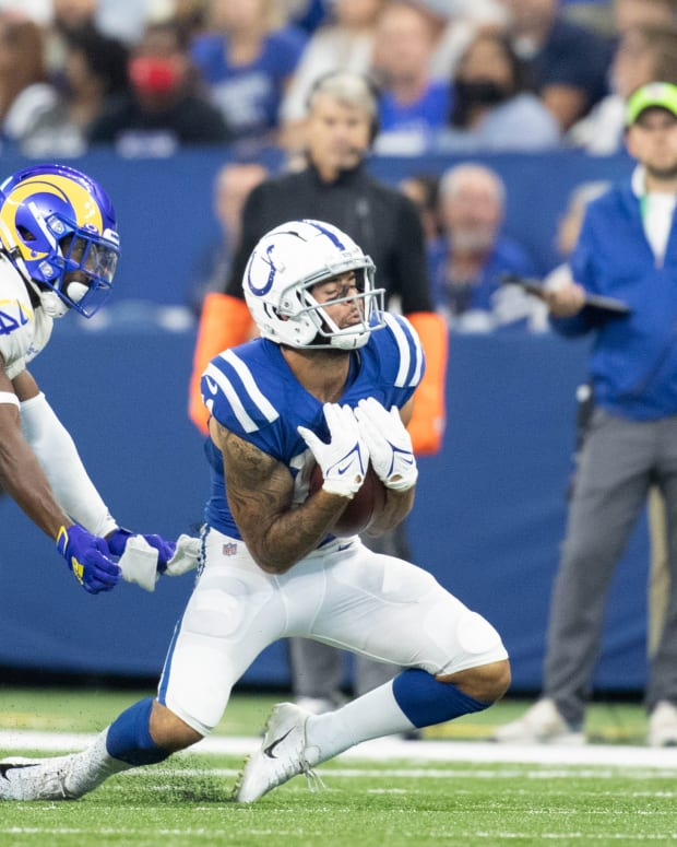 Sep 19, 2021; Indianapolis, Indiana, USA; Indianapolis Colts wide receiver Michael Pittman (11) catches the ball while Los Angeles Rams safety Jordan Fuller (4) defends in the first quarter at Lucas Oil Stadium.