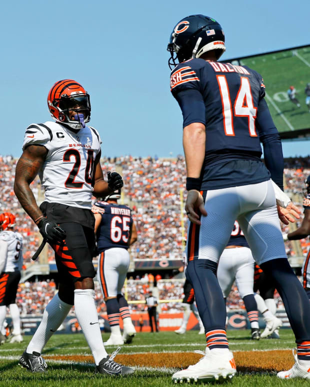 Sep 19, 2021; Chicago, Illinois, USA; Cincinnati Bengals strong safety Vonn Bell (24) talks to Chicago Bears quarterback Andy Dalton (14) after a play and was penalized for taunting during the first quarter at Soldier Field. Mandatory Credit: Jon Durr-USA TODAY Sports