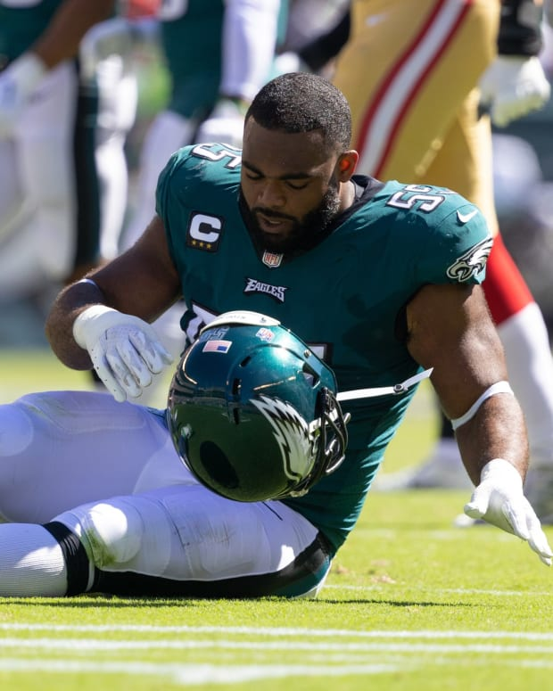 Sep 19, 2021; Philadelphia, Pennsylvania, USA; Philadelphia Eagles defensive end Brandon Graham (55) takes off his helmet after being injured during the second quarter against the San Francisco 49ers at Lincoln Financial Field.