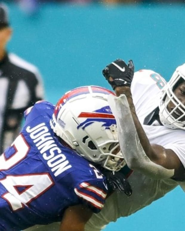 Buffalo Bills cornerback Taron Johnson (24) tackles Miami Dolphins wide receiver Preston Williams (18) during the third quarter of the game at Hard Rock Stadium.