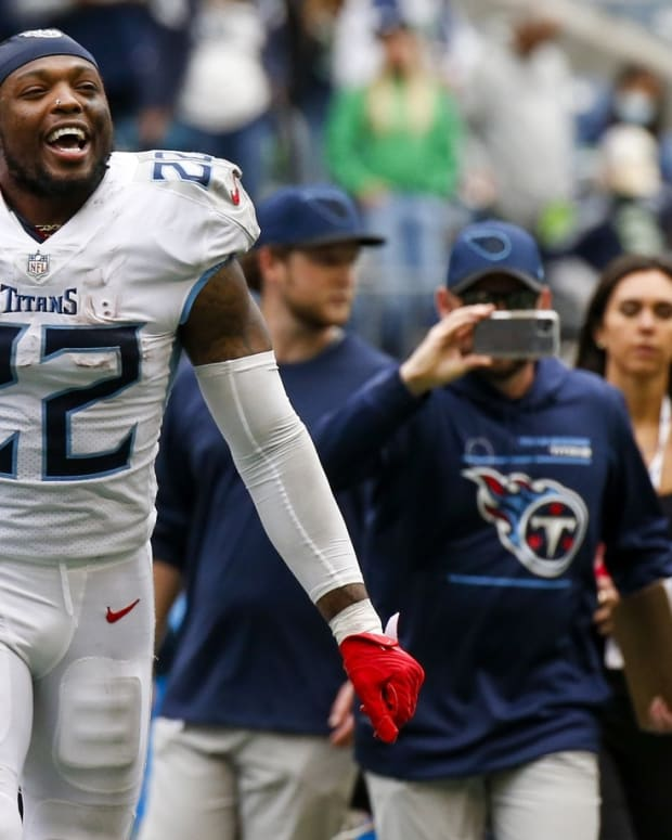 Tennessee Titans running back Derrick Henry (22) celebrates following a 33-30 overtime victory against the Seattle Seahawks at Lumen Field.