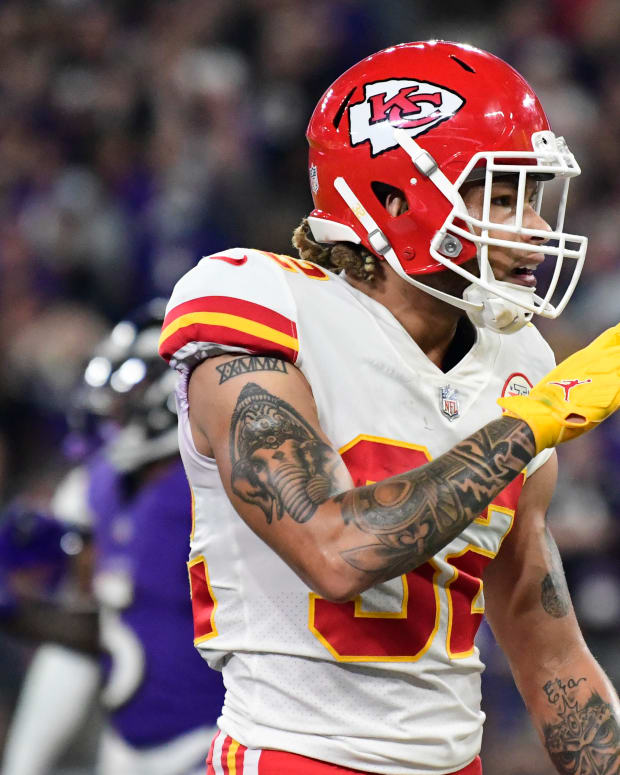 Sep 19, 2021; Baltimore, Maryland, USA; Kansas City Chiefs safety Tyrann Mathieu (32) signals to the stands during the fourth quarter against the Baltimore Ravens at M&T Bank Stadium. Mandatory Credit: Tommy Gilligan-USA TODAY Sports