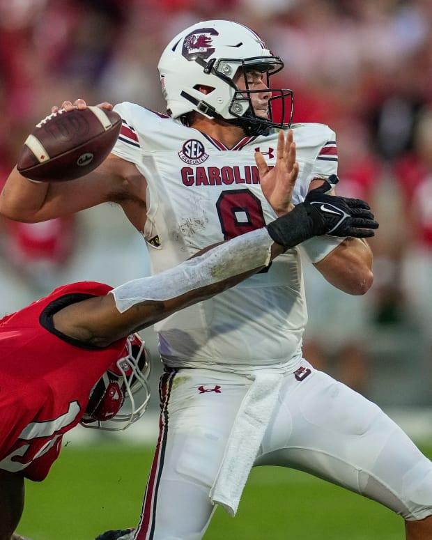 Sep 18, 2021; Athens, Georgia, USA; South Carolina Gamecocks quarterback Zeb Noland (8) is hit by Georgia Bulldogs linebacker Adam Anderson (19) during the first quarter at Sanford Stadium.