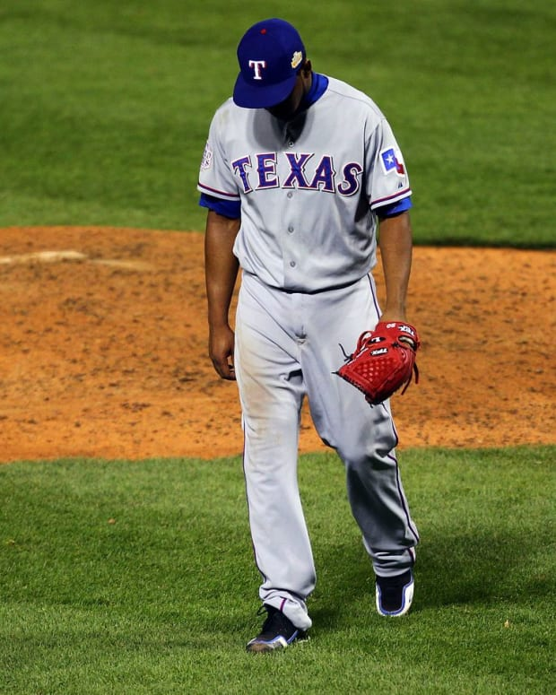 Neftali Feliz of the Texas Rangers walks off the mound at the end of the ninth inning during Game Six of the MLB World Series against the St. Louis Cardinals at Busch Stadium in St Louis, Missouri. (Photo by Dilip Vishwanat/Getty Images)