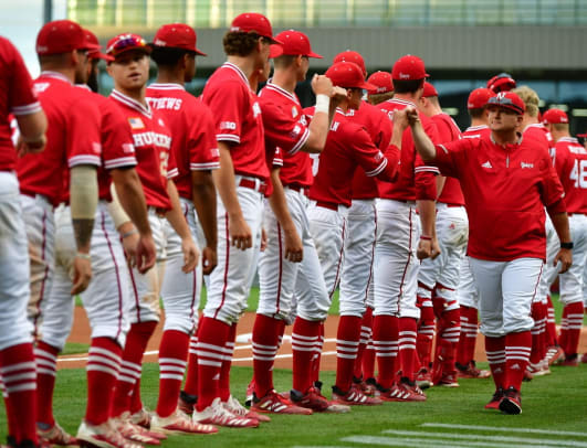 Will Bolt greets his players before the start of Sunday's game vs. Arkansas baseball 2021