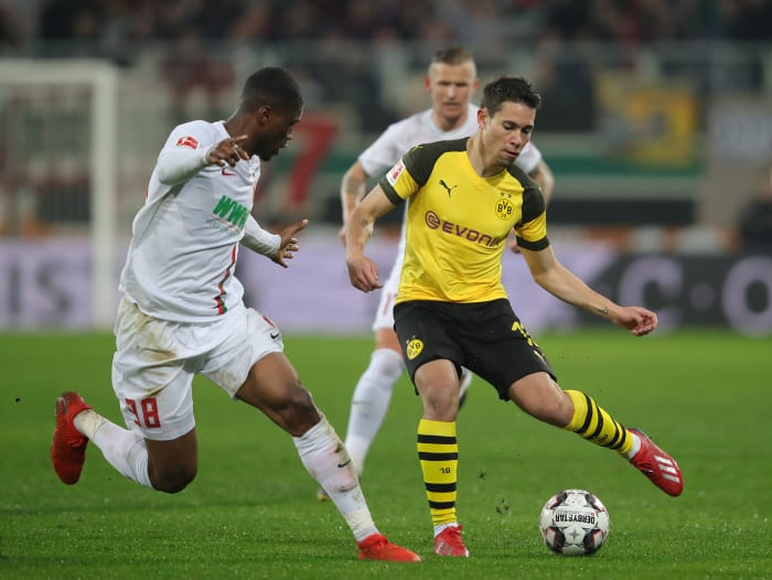 Marco Reus of Borussia Dortmund is challenged by Caiuby of ...  |Augsburg--dortmund