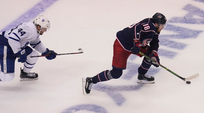 Pierre-Luc Dubois's hat trick, overtime game-winner put Blue Jackets one win away from advancing to the NHL Stanley Cup Playoffs.