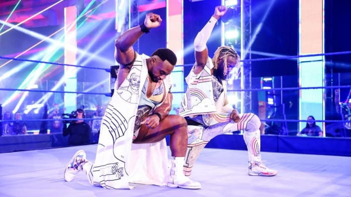 WWE's Big E and Kofi Kingston kneel in the ring on SmackDown