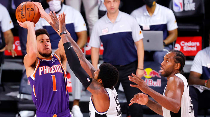 Aug 4, 2020; Lake Buena Vista, USA; Devin Booker #1 of the Phoenix Suns shoots the game winning basket over Paul George #13 of the LA Clippers at The Arena at ESPN Wide World Of Sports Complex on August 04, 2020 in Lake Buena Vista, Florida.