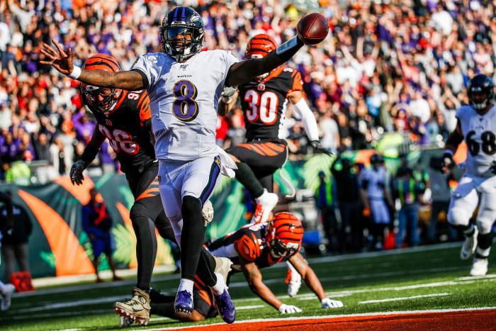 Lamar Jackson scores on a long touchdown run against the Bengals