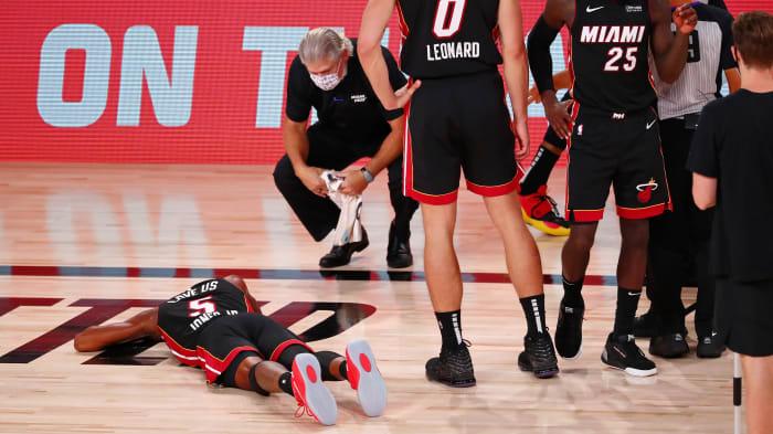 Heat forward Derrick Jones Jr. suffers an injury against the Pacers.