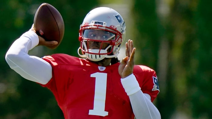 Cam Newton throws a pass at Patriots training camp